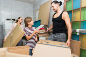 Family packing boxes — Stock Photo