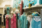 clothes shop with blue dresses — Stock Photo