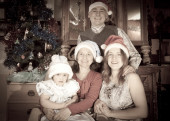 happy family in Santa hat celebrating Christmas  — Stock fotografie