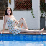 Girl in dress resting near pool — Stock Photo #59492459