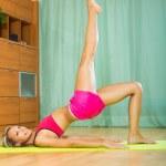 Female doing yoga at home — Stock Photo #59493283