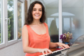 Female musician playing sequencer — Stock Photo