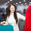 Woman choosing sweater at clothing shop — Stock Photo #59515715