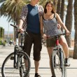 Young couple with bicycles — Stock Photo #59516411