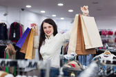 Joyful girl with shopping bags — Stock Photo