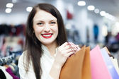 Girl with bags at clothing boutique — Stock Photo