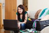 girl choosing the resort at internet   — Stock Photo