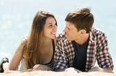 Joyful couple on sandy beach — Stock Photo
