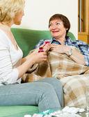 mature women with liquid medicine   — ストック写真