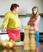 Mother with daughter at kitchen — Stock Photo