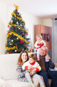 Family with Christmas tree — Stock Photo
