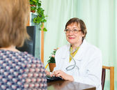 Female  doctor and patient talking  — Stockfoto
