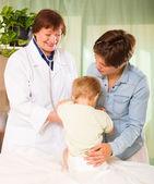 Doctor examining baby — Stock Photo