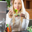 Businesswoman having lunch in office — Stock Photo #59530615