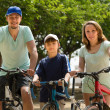 Couple with son on bicycles — Stock Photo #59530733