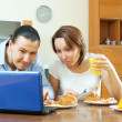 Ordinary couple looking e-mail in laptop during breakfast — Stock Photo #59533391