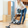 woman cleaning with vacuum cleaner  — Stock Photo #59533927