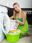 girl in green dress using washing machine   — Stock Photo