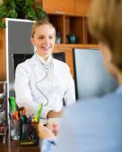 Positive female doctor discharging patient — Stock Photo