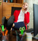 Female employee  speaking by mobile — Stock Photo