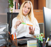 Woman doing manicure at office — Stock Photo