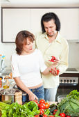 Woman and man  adding spices to the pot — Stock Photo