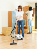 Happy couple doing housework — Stock Photo
