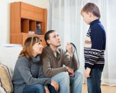 Mother and  father with belt berating  boy   — Foto de Stock