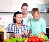 Happy family cooking veggy lunch — Stock Photo