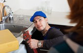Plumber repairing a kitchen sink — Stock Photo