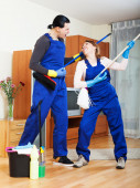 Playful cleaning premises team in uniform — Stock Photo