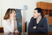 Serious couple talking in home — Stock Photo
