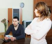 Dissapointed woman against husband — Stock Photo