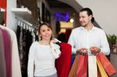 Couple with bags at fasion store — Stock Photo
