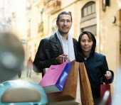 Couple with purchases at street — Stock Photo
