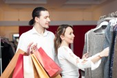 couple with shopping bags   at  shop — Stock Photo