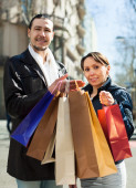 Couple with purchases — Stock Photo