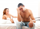 Sad man with problem in bed — Stock Photo