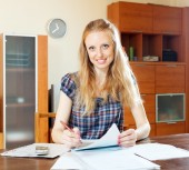 Woman reading financial document at home — Foto Stock