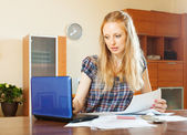 Serious  woman reading document at home — Stock Photo