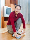 woman rubing  floor with  polish — Stock Photo