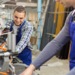 Couple of workmen at factory — Stock Photo #60113369