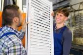 Two careful workmen inspecting windows — Stockfoto