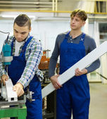 Couple of workmen at factory — Stock Photo