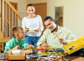 Family with the working tools — Foto de Stock