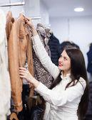 Woman choosing jacket — Stock Photo