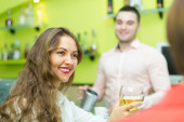 Girls flirting with barman — Stock Photo