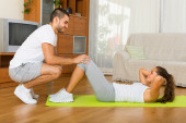 Couple doing exercises — Foto Stock