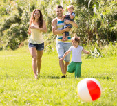 Parents with  kids outdoors — Stock Photo