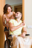 Couple with spouse in wheelchair — Stock Photo